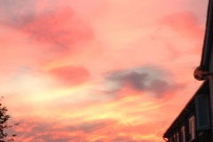 436 - Sunset, a few years back between the roofs.